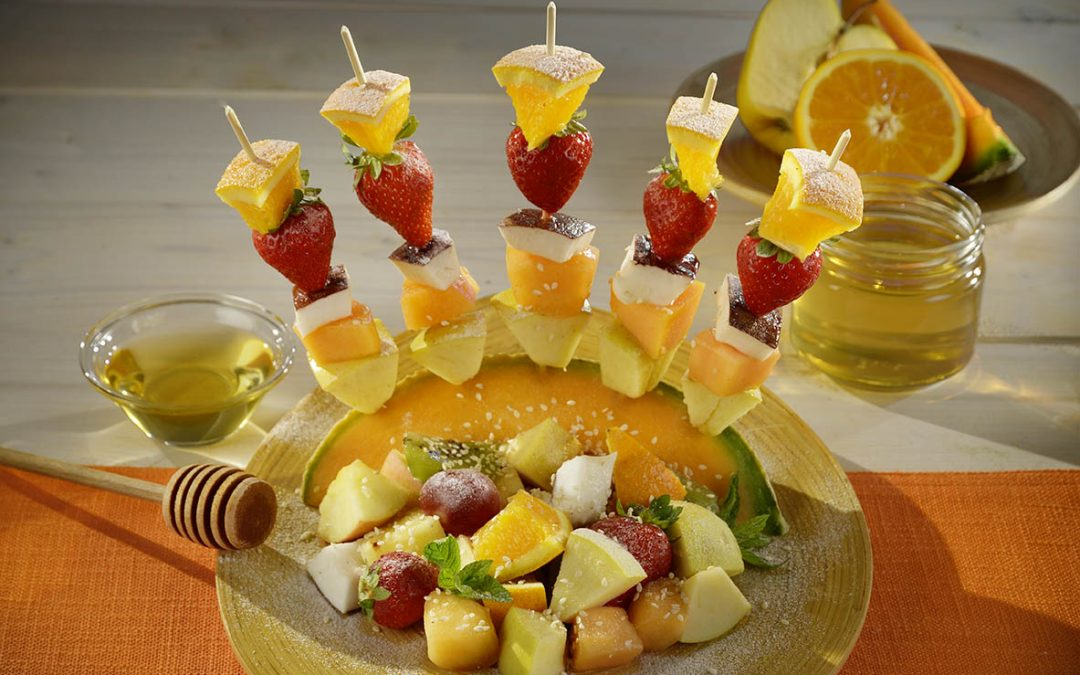 Fruit skewers with sesame seeds and acacia honey